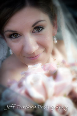 Bride with flowers wedding day.  Wedding photographer in Freehold NJ. Special event photographer in Freehold New Jersey.